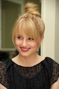 Straight blonde wrapped bun updo with long face framing wispy bangs hairstyle wi...