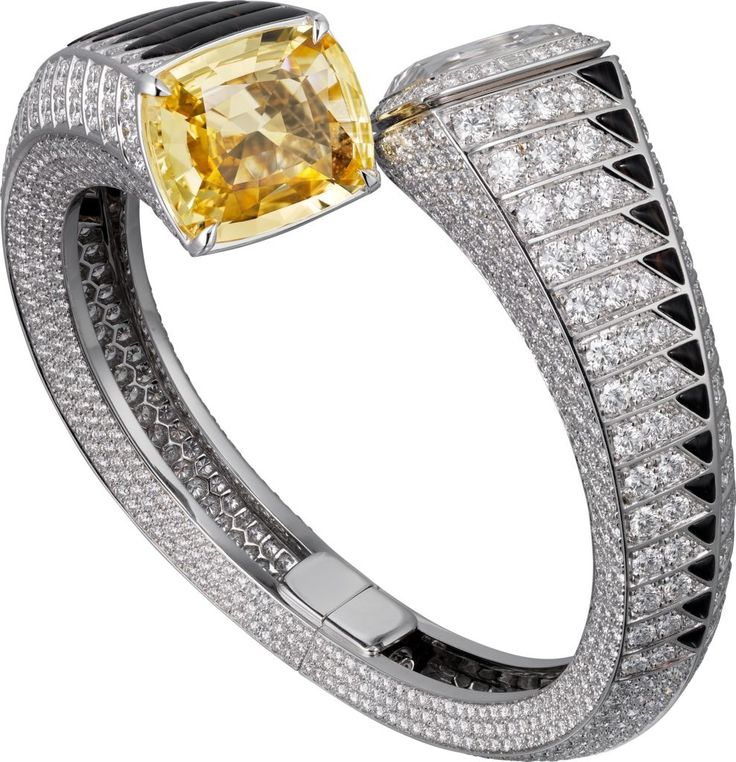 CARTIER. High Jewellery visible hour watch, one 19.20-carat cushion-shaped yello...