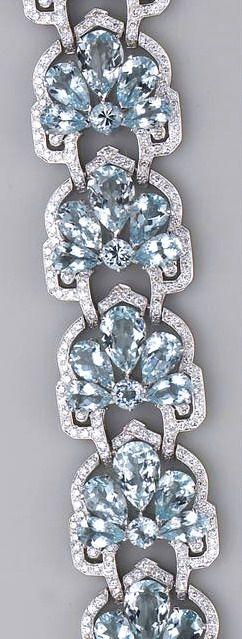 An aquamarine, diamond and eighteen karat white gold bracelet the flexible brace...