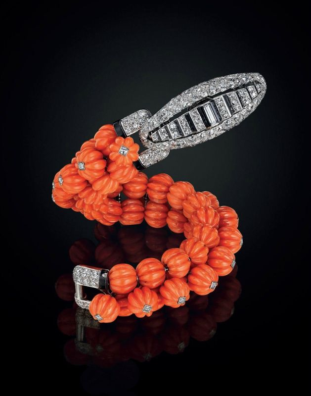 An Art Deco coral, diamond and onyx bracelet, by Cartier....