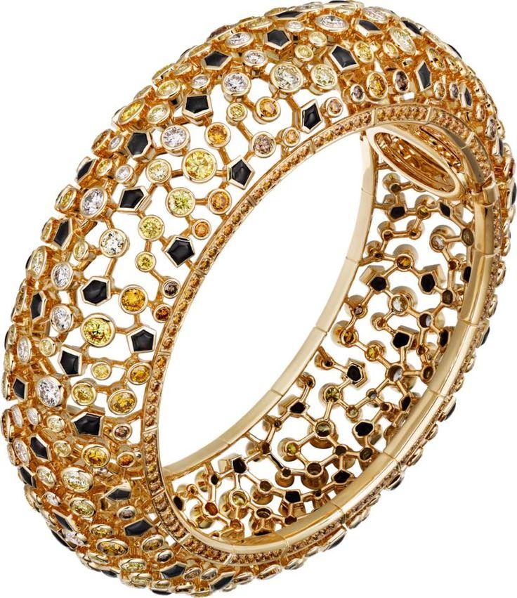 CARTIER. Bracelet - or jaune, obsidiennes, diamants bruns, orange, jaunes et bla...
