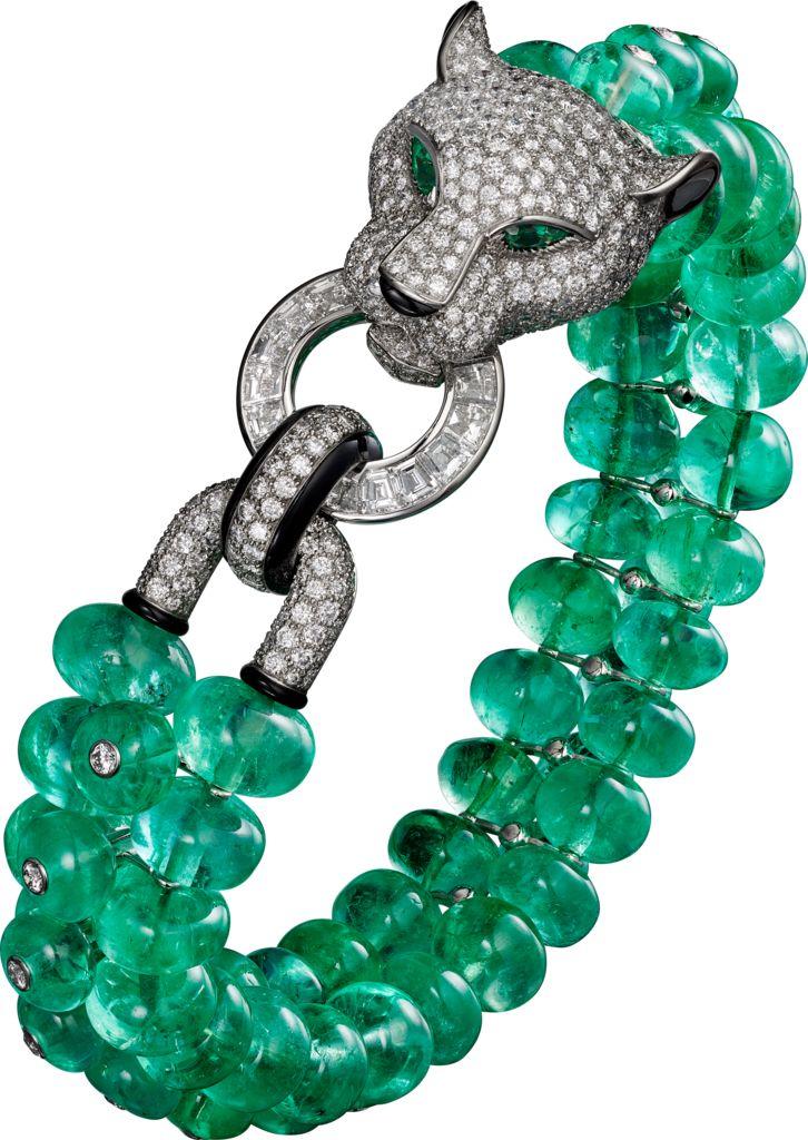 CARTIER. Bracelet - platinum, emerald beads, onyx, pear-shaped emerald eyes....