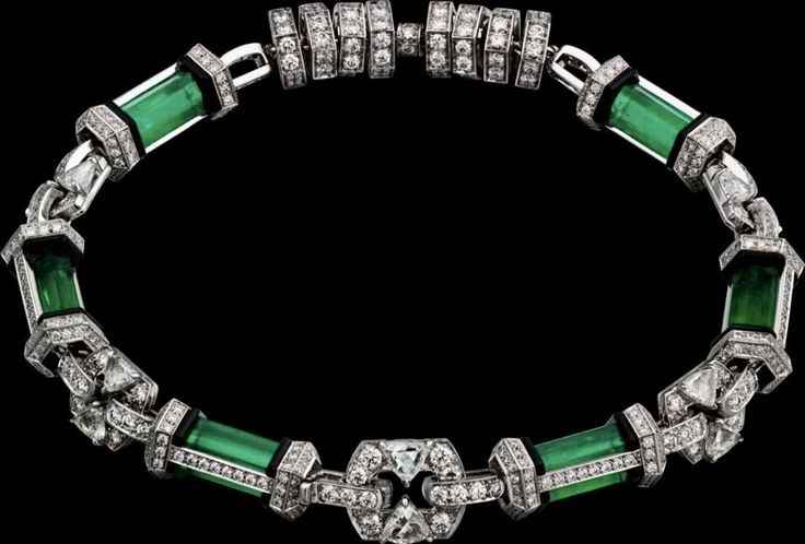 CARTIER. Bracelet - platinum, emeralds, triangular-shaped briolette-cut diamonds...