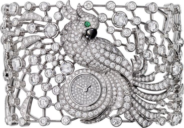 CARTIER. Montre heure apparente Haute Joaillerie décor perroquet, mouvement à ...