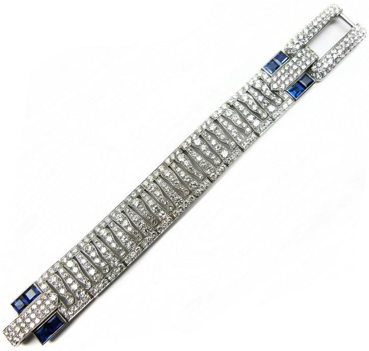 Diamond and sapphire strap bracelet by Cartier , of diamond 'tiger stripe&#3...