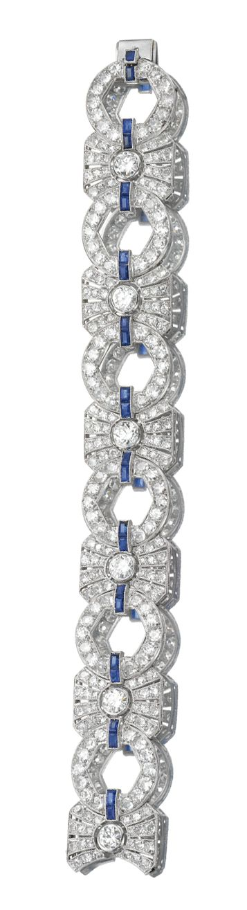 DIAMOND BRACELET, 1930s. Designed as a series of geometric links connected by ca...