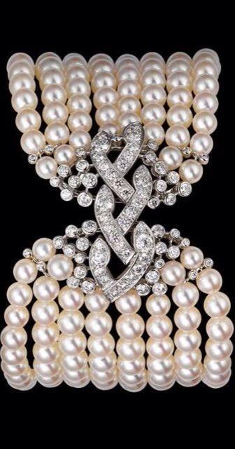 Diamond, Pearl and Platinum bracelet by Cartier....
