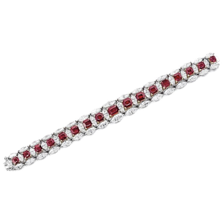 Ruby and Diamond Bracelet Set with seventeen graduated octagonal rubies weighing...