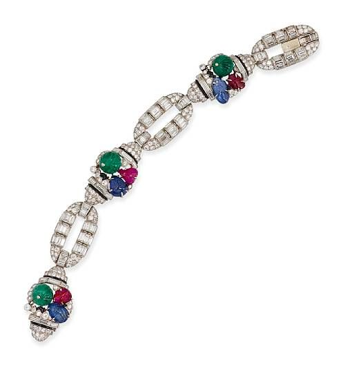 This Art Deco tutti frutti bracelet was made by Mauboussin in 1930. It presents ...