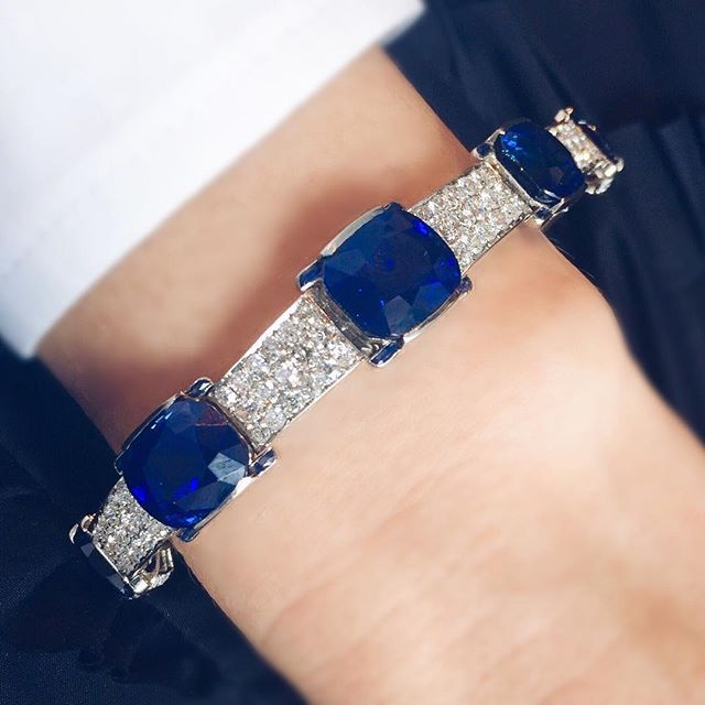 This bracelet has it all. It's Cartier and set with a series of Kashmir Sapp...