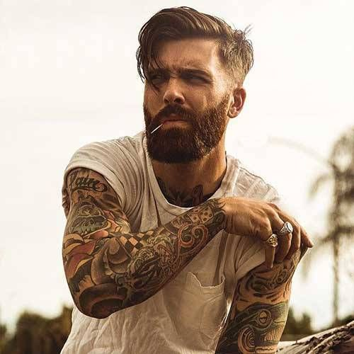 medium hair undercut hairstyle with beard...