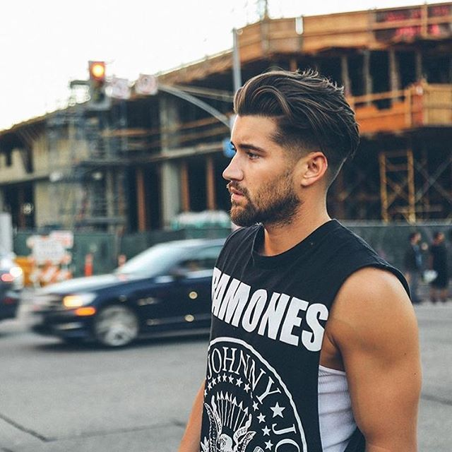 Fashionable Mens Haircuts Pairing A Long Flow Top With A Low