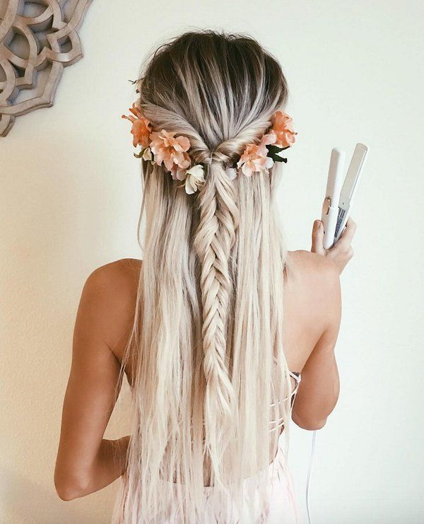 fishtail hairdo. Half down half up hairdo. She is also wearing flowers. Festival...