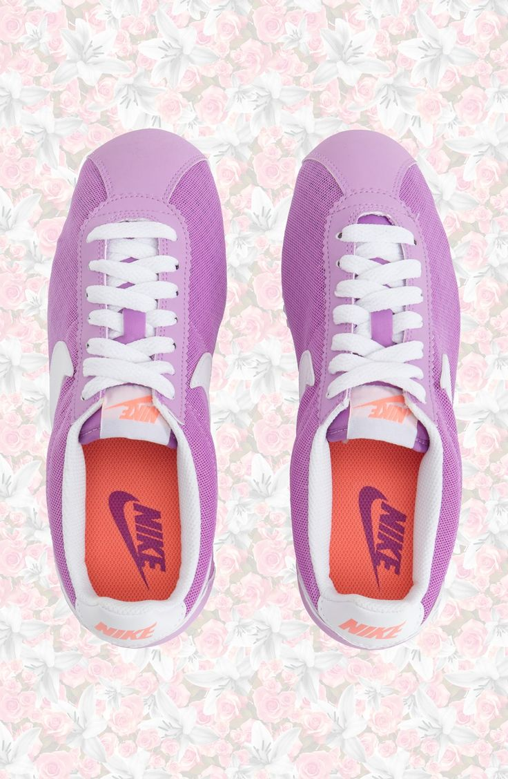Kick back in classic '70s running style with these cute fuchsia Nikes....