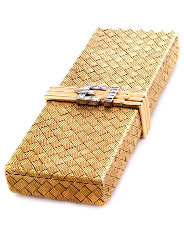 Gold cosmetic box with diamonds Length: circa. 15.5 cm. Width: circa 5.7 cm. Wei...