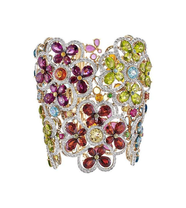 18k gold and palladium flower motif bracelet in a rainbow of sapphires and fancy...
