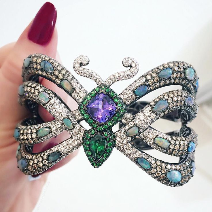 """A bejeweled @wendyyuejewellery butterfly cuff in honor of today's beautiful s..."