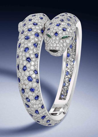 "A diamond, sapphire, emerald and onyx ""Panthère"" bracelet, by Cartier..."