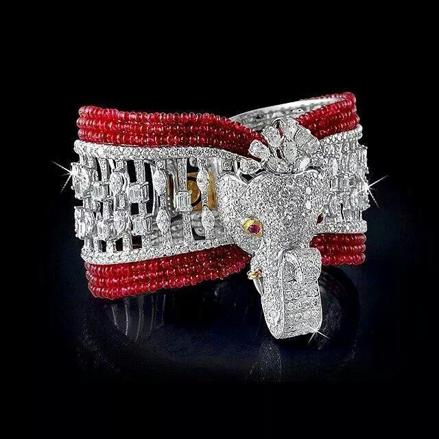 A diamond & spinal bead elephant cuff bracelet.