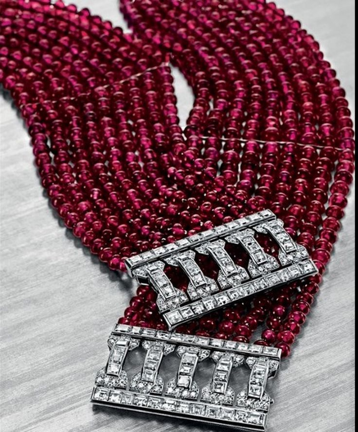 A Pair of Art Deco Ruby Bead and Diamond Bracelets, by Cartier Designed as nine ...