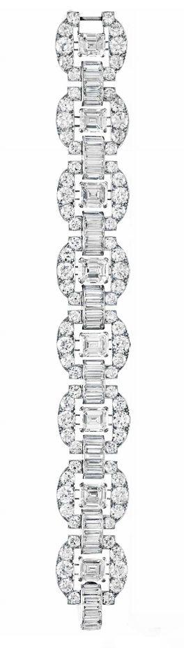 AN ART DECO DIAMOND BRACELET, BY CARTIER Designed as a series of rectangular-cut...