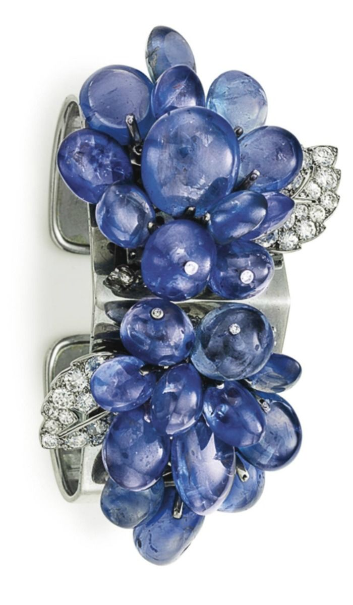 AN ART DECO SAPPHIRE AND DIAMOND CUFF BRACELET, BY CARTIER: Set at the top with ...