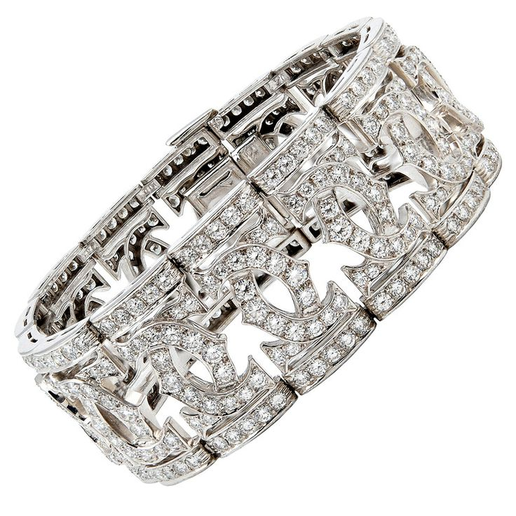 CARTIER Diamond 'Double C' Bracelet | From a unique collection of vintage cuff b...