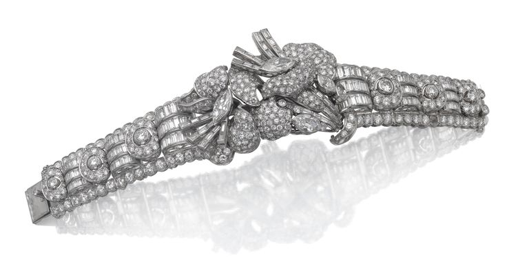 Diamond bracelet, 1950s Of scroll and floral design set with baguette, marquise-...