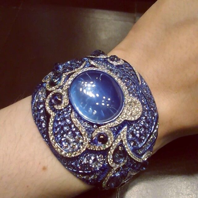 Spectacular cuff bracelet crafted in titanium with moonstones, sapphires and dia...
