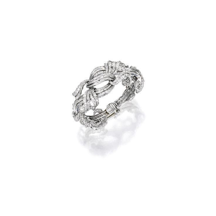 Platinum and Diamond Bracelet Designed as a stylized foliate vine, set with vari...