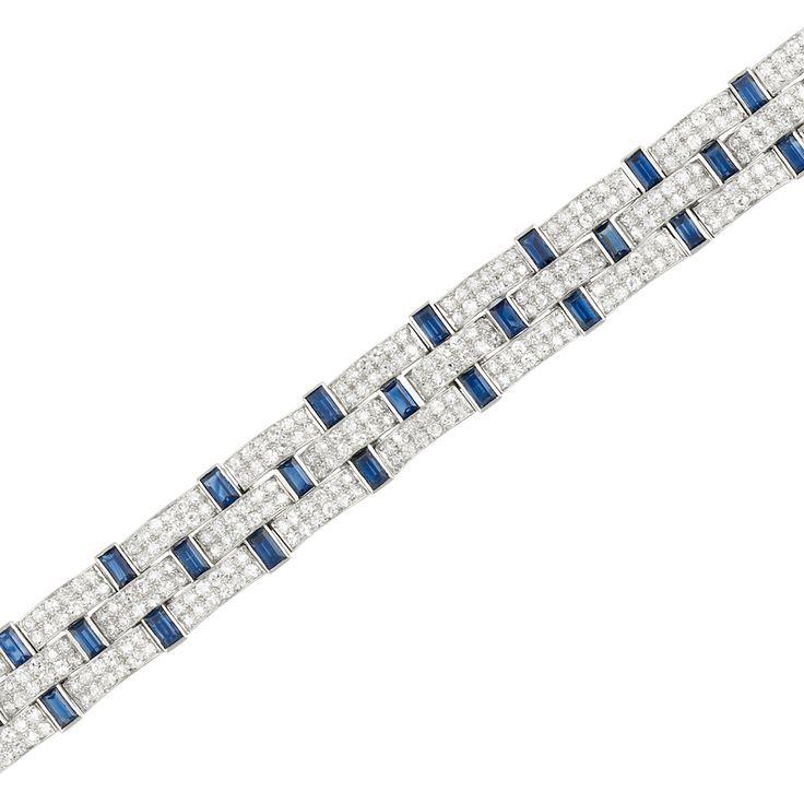 Platinum, Diamond and Sapphire Bracelet, Cartier, France The woven bracelet comp...