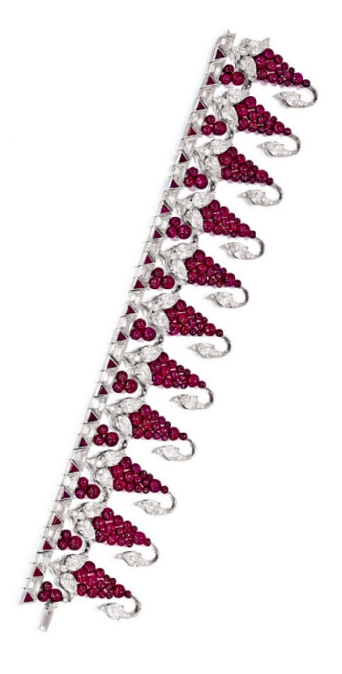 Ruby and Diamond Bracelet, Bhagat. Meticulously set with links designed as grape...