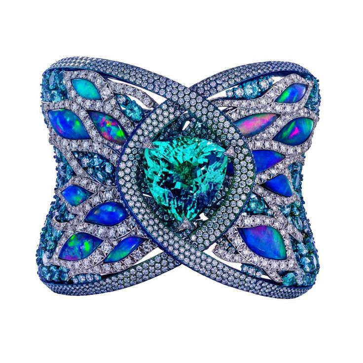 This spectacular fine jewellery Arunashi cuff set in blue titanium and gold feat...