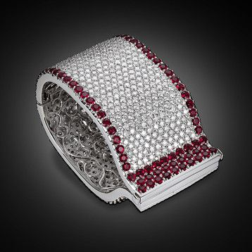This stunning diamond and ruby cuff bracelet makes a bold impact. Laden with app...