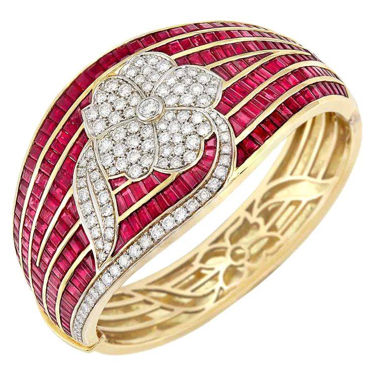 Two-Color Gold, Ruby and Diamond Cuff Bangle Bracelet, Adler The wide tapered ba...