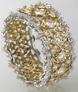 white gold, yellow gold, and diamond Buccellati ring....