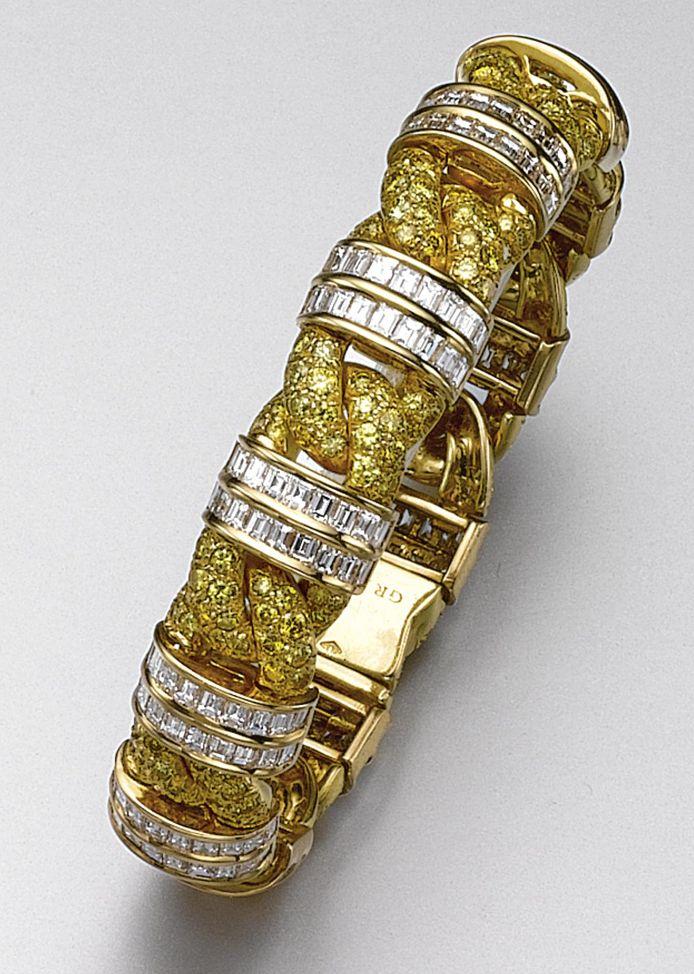 YELLOW DIAMOND AND DIAMOND BRACELET, GRAFF. Designed as a braid, pavé-set with ...