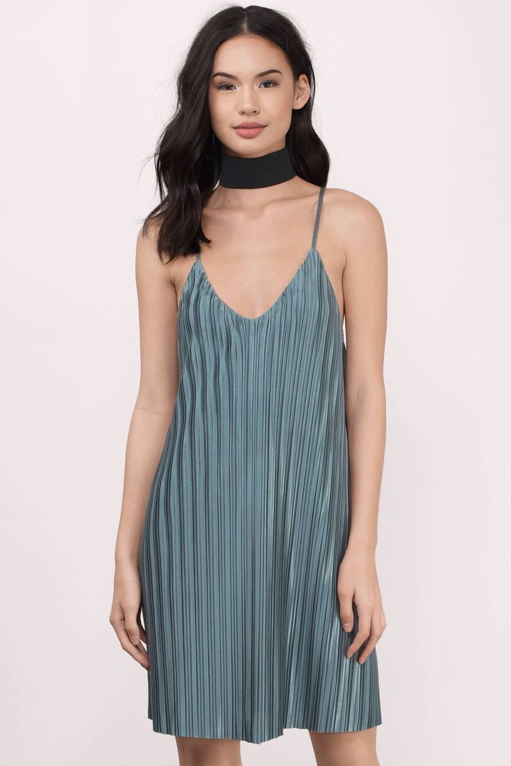 This teal satin pleated shift dress is perfect for getting dolled up!...
