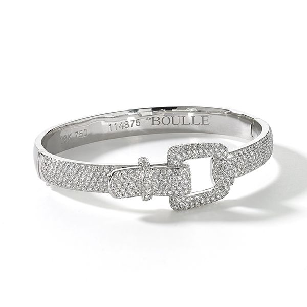 No reason to become unhinged, over 4 cts. of diamonds set this buckle ablaze.