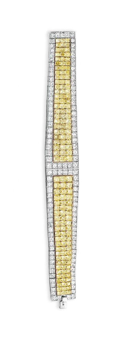 A COLORED DIAMOND AND DIAMOND BRACELET, BY DAVID MORRIS Designed as a square-cut...