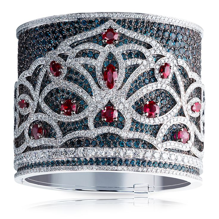 A Fabergé bangle set in 18K white gold and features 2,172 alexandrites, rubies ...