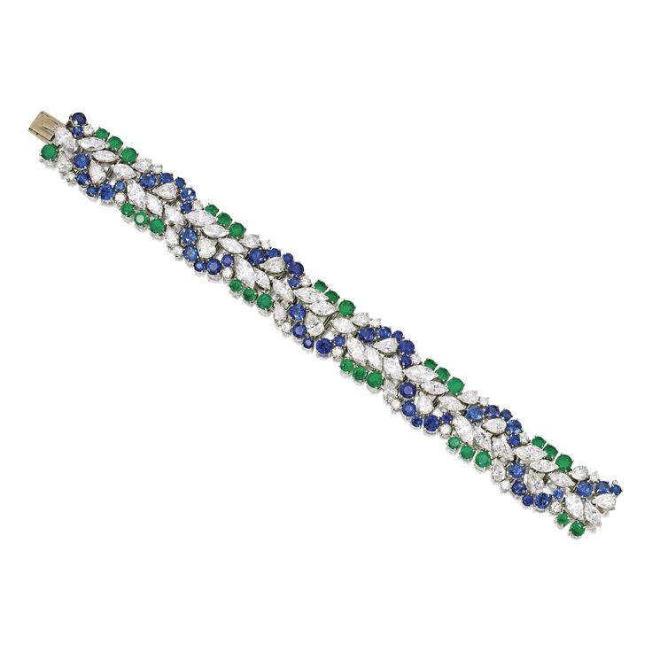A Platinum, Diamond, Emerald and Sapphire Bracelet, Cartier, Circa 1970 set with...