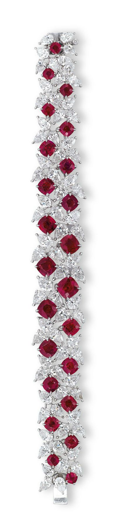 A RARE RUBY AND DIAMOND BRACELET, BY FAIDEE The highly articulated pear-shaped d...