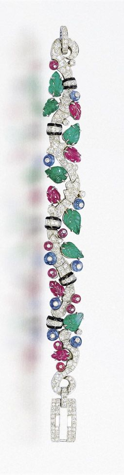 A SUPERB ART DECO SAPPHIRE, EMERALD, RUBY, ENAMEL AND DIAMOND 'TUTTI FRUTTI&...