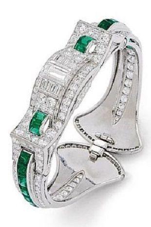 An Art Deco Emerald, Diamond and Platinum Bangle Bracelet, Oscar Heyman, circa 1...