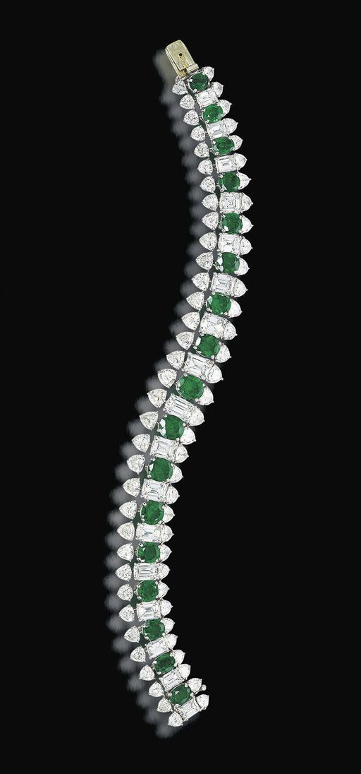 AN EMERALD AND DIAMOND BRACELET, BY HARRY WINSTON Designed as a series of oval-s...