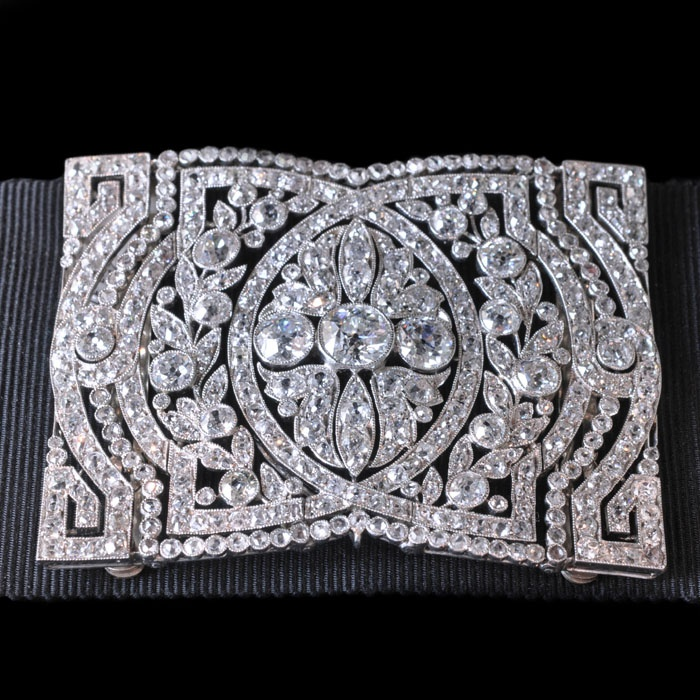 Collier de chien plaque of platinum and diamonds. This is worn on a grosgrain or...