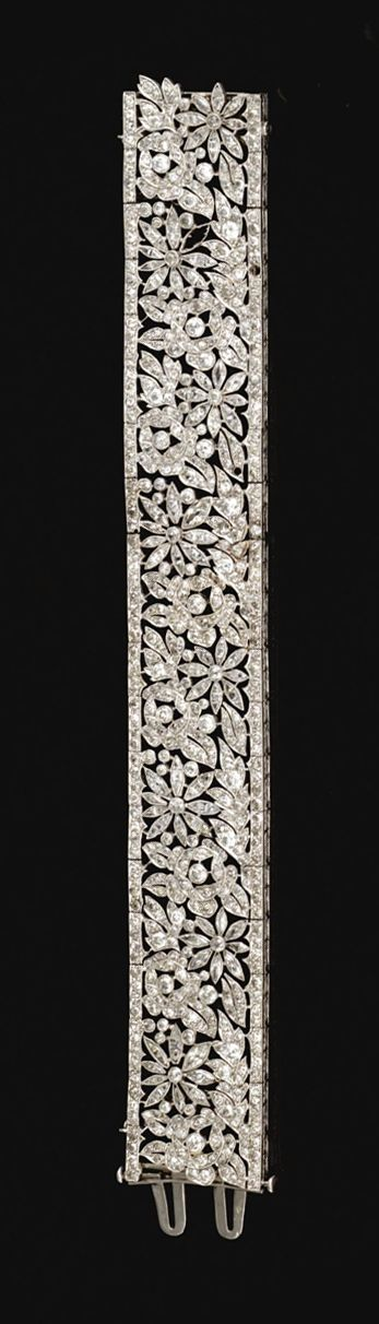 DIAMOND BRACELET, FRENCH, CIRCA 1915. The articulated open work band decorated w...