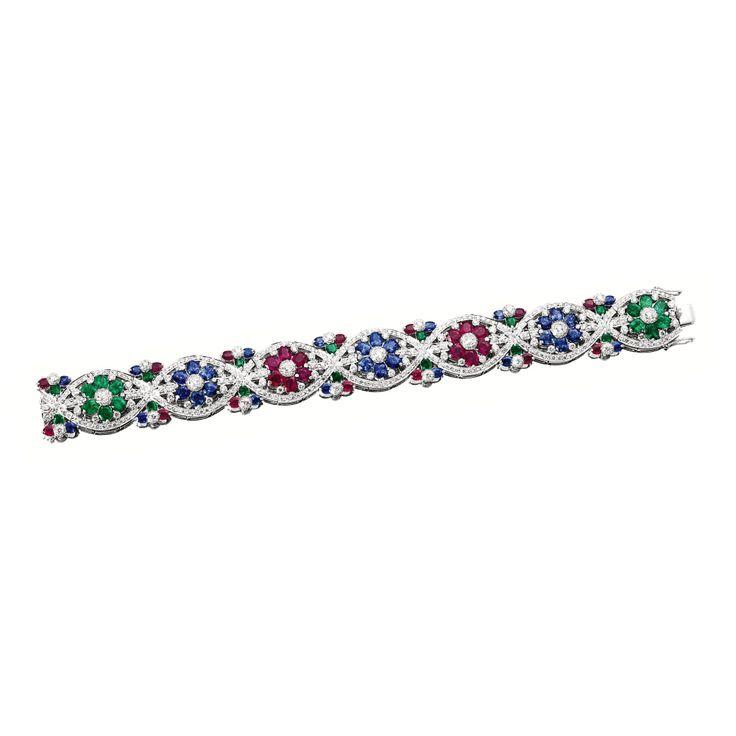 GEM-SET AND DIAMOND BRACELET The articulated strap composed of seven navette-sha...