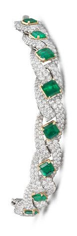 A fine emerald and diamond bracelet, by Cartier, circa 1960 The articulated brac...